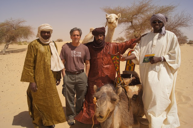 Caravan to Class Founder and Executive Director Barry Hoffner pictured with a group during a recent visit to Mali