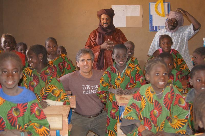 Caravan to Clas Founder and Executive Director Barry Hoffner with students in their new school in Mali