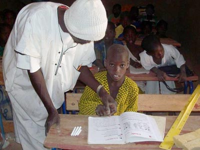 Image of a teacher and student at one of Caravan to Class' schools in Mali