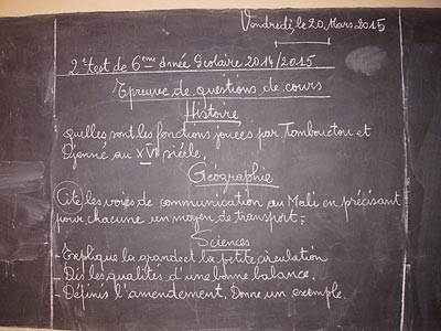 Image of classroom lessons on a blackboard at the Tombouz school