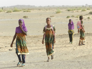 A groups of girls walking to their school in Samdiar built by Caravan to Class