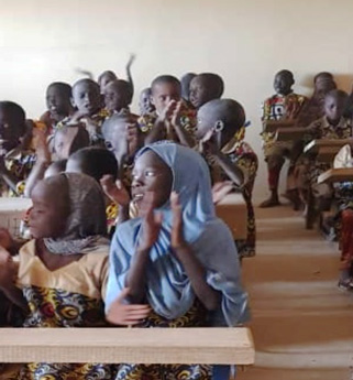 image of students at there desks in Caravan To Class' new Bokoi-Koiria school