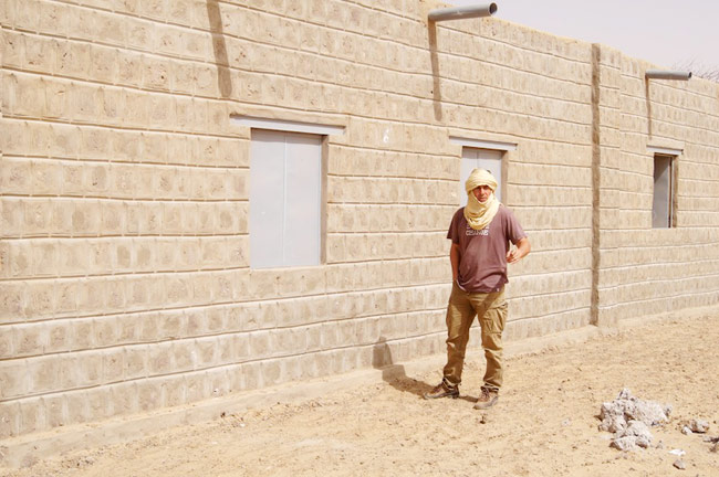 Image of Caravan to Class Founder Barry Hoffner standing in front of the rehabilitated school in Tehsaq, Mali